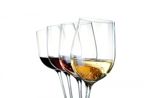 Four wineglasses with different colors of wine